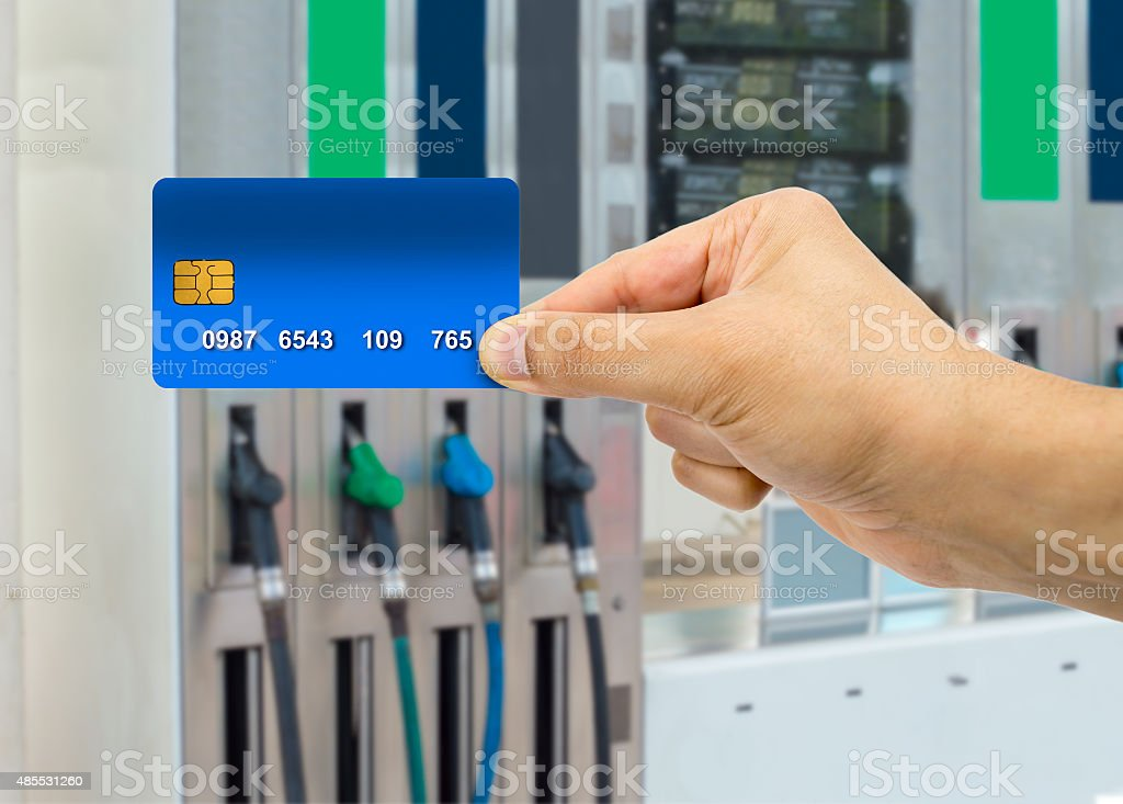 payment at the gas station with credit card stock photo