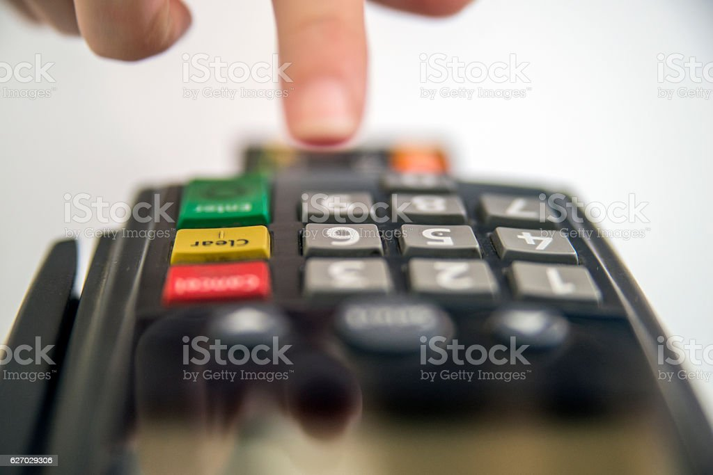 Payment card in a bank terminal. stock photo