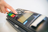 Payment card in a bank terminal.