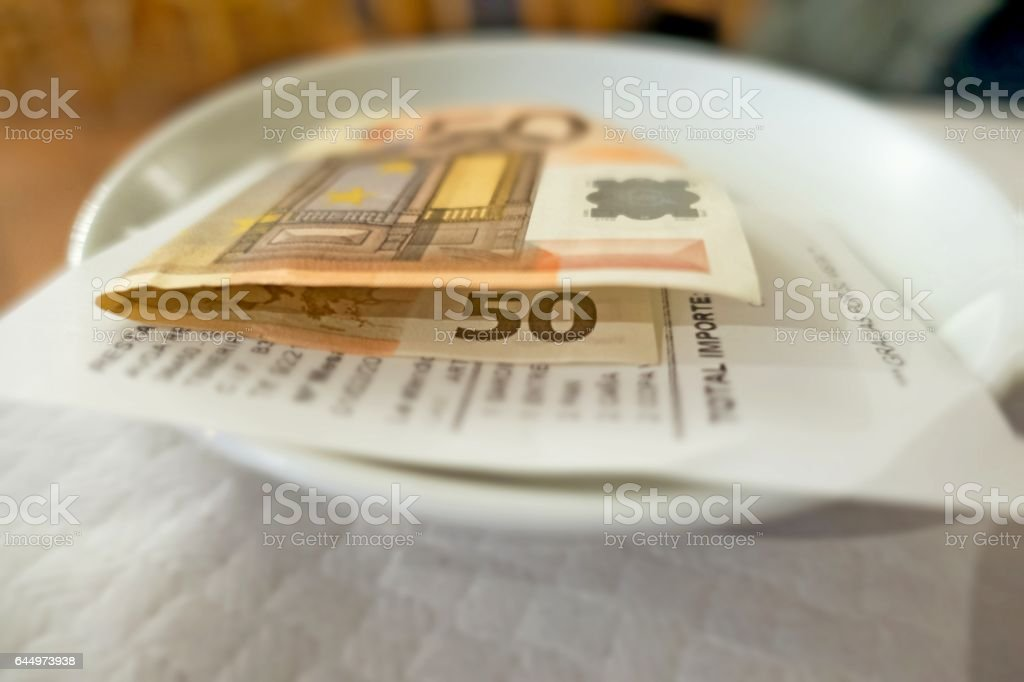 Payment left for restaurant meal stock photo