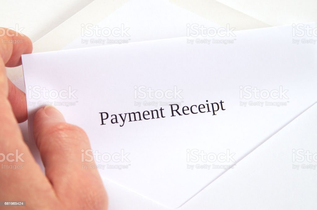 Payment Receipt printed on white paper and envelope, hand holding it, white background stock photo
