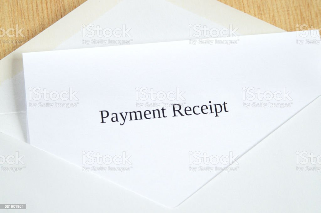Payment Receipt printed on white paper and envelope, wooden background stock photo