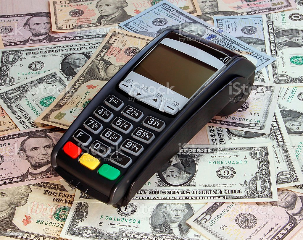 Payment terminal and money stock photo
