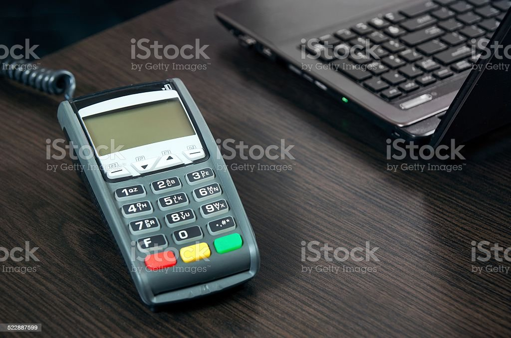 Payment terminal in the office. Laptop in the background stock photo