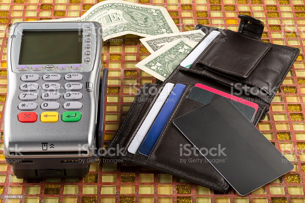 Payment wireless terminal and wallet with dollar banknote stock photo