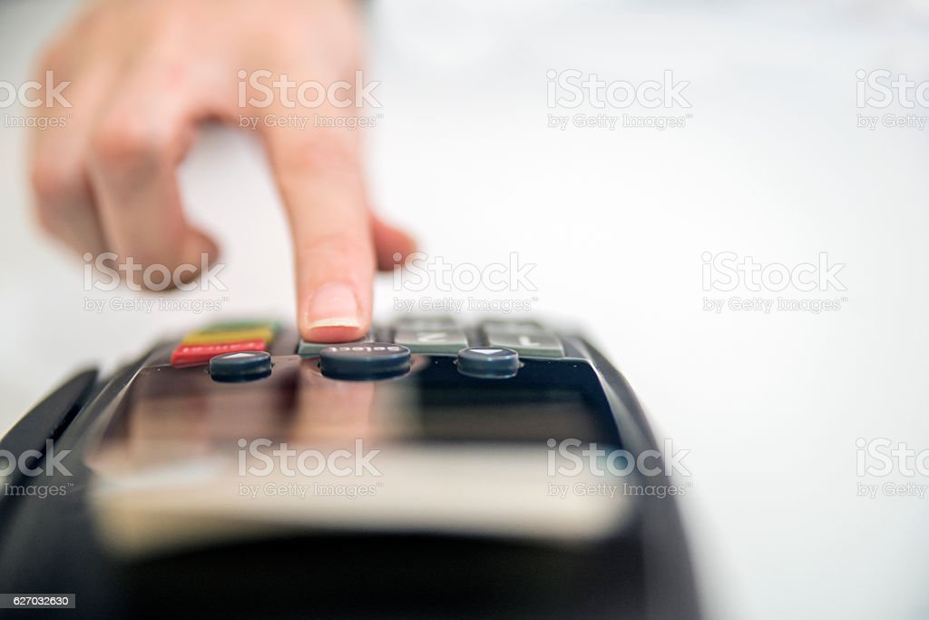 Payment with credit card - businessman holding pos terminal. han stock photo