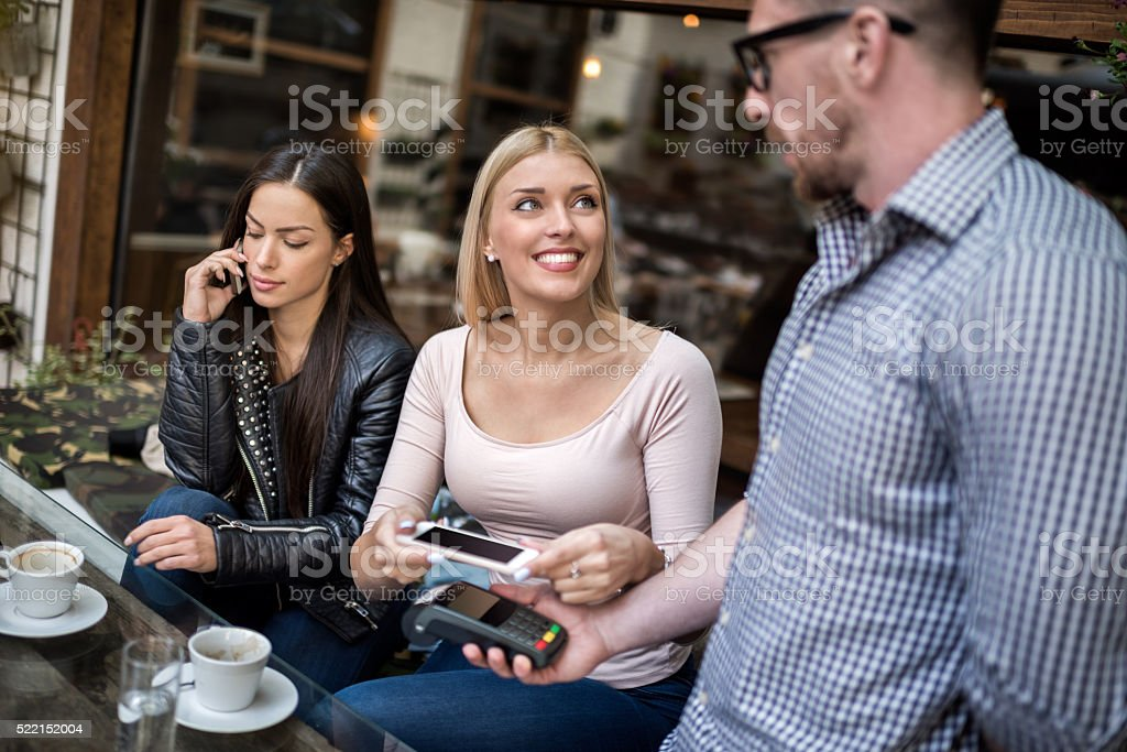 NFC payment with mobile phone stock photo