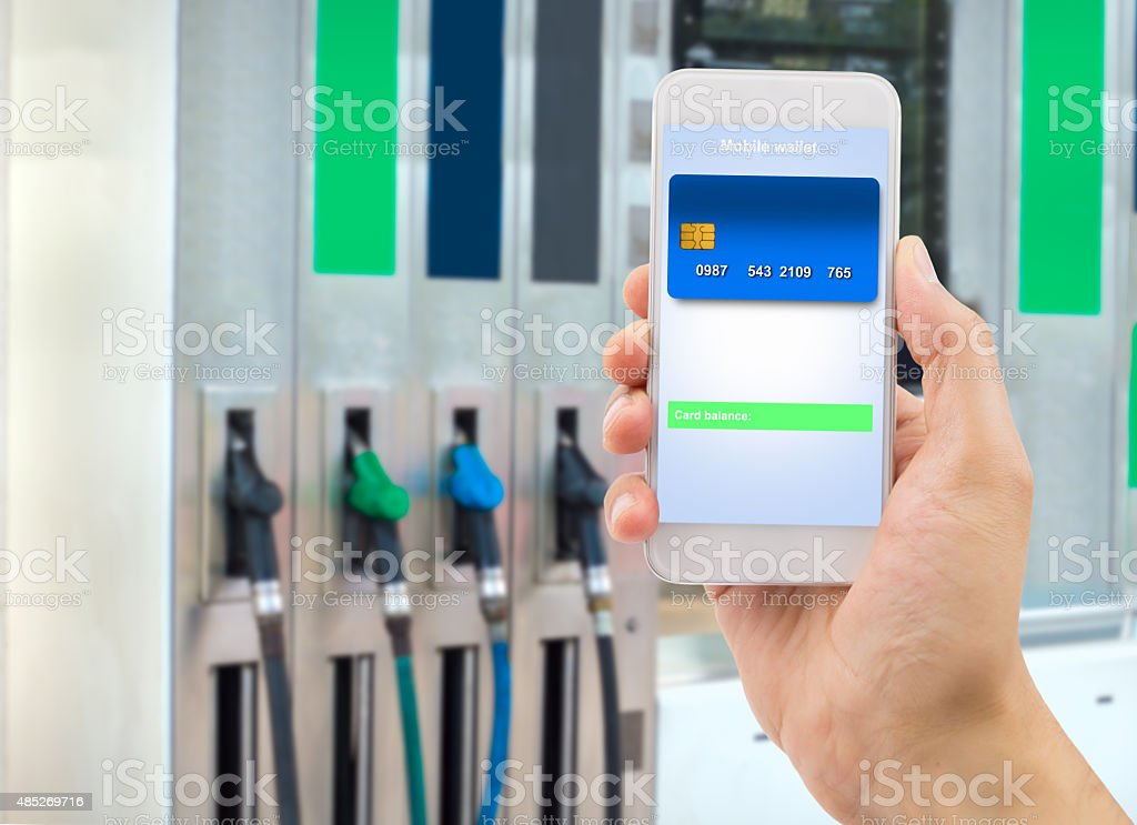payment with my smartphone at the store stock photo