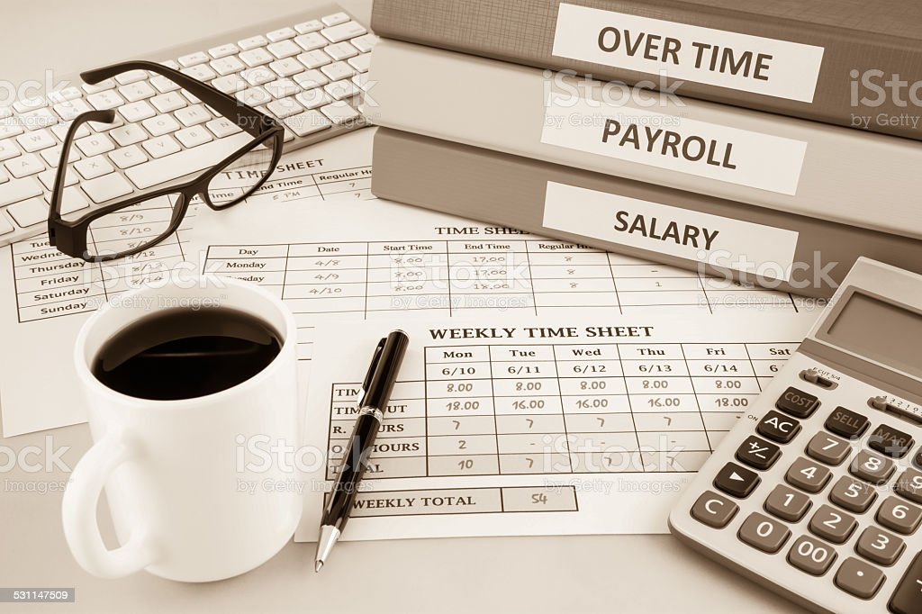 Payroll time sheet for human resources, sepia tone stock photo