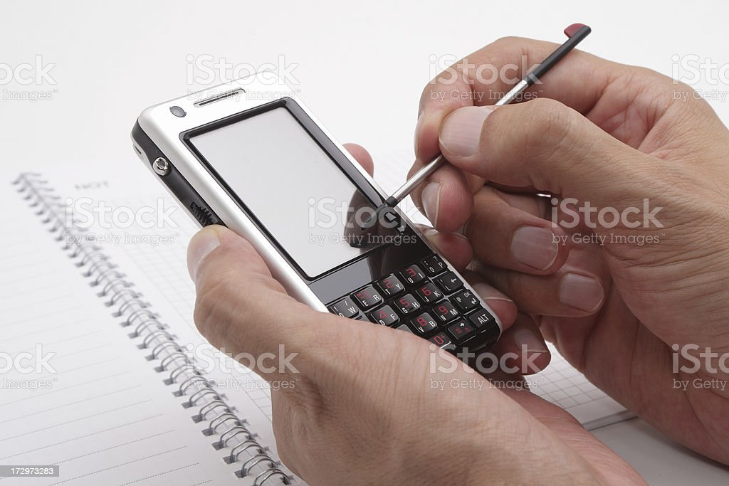 Pda with hand royalty-free stock photo