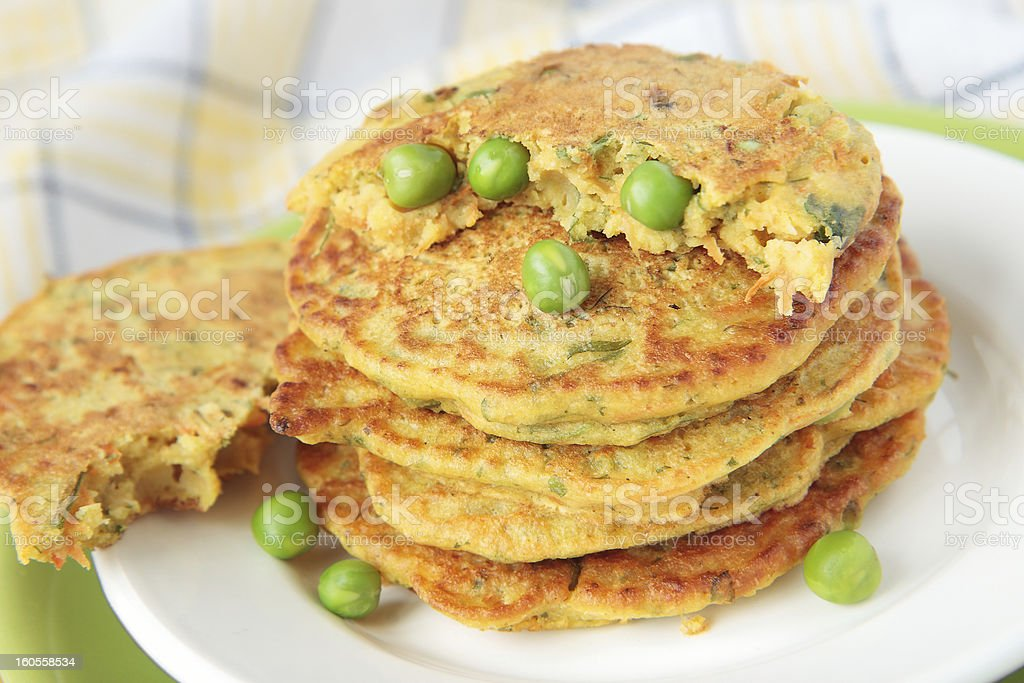 Pea flour fritters with green peas, carrots, parsley royalty-free stock photo