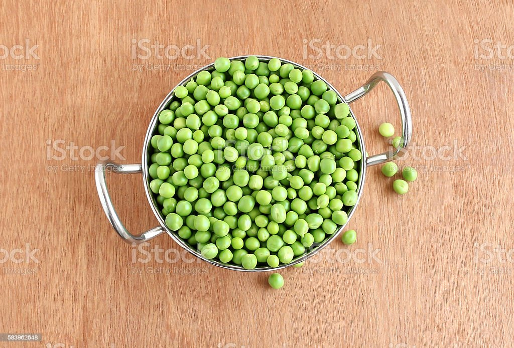 Pea in a Steel Utensil stock photo