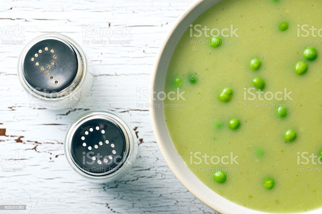 pea soup and salt shaker stock photo