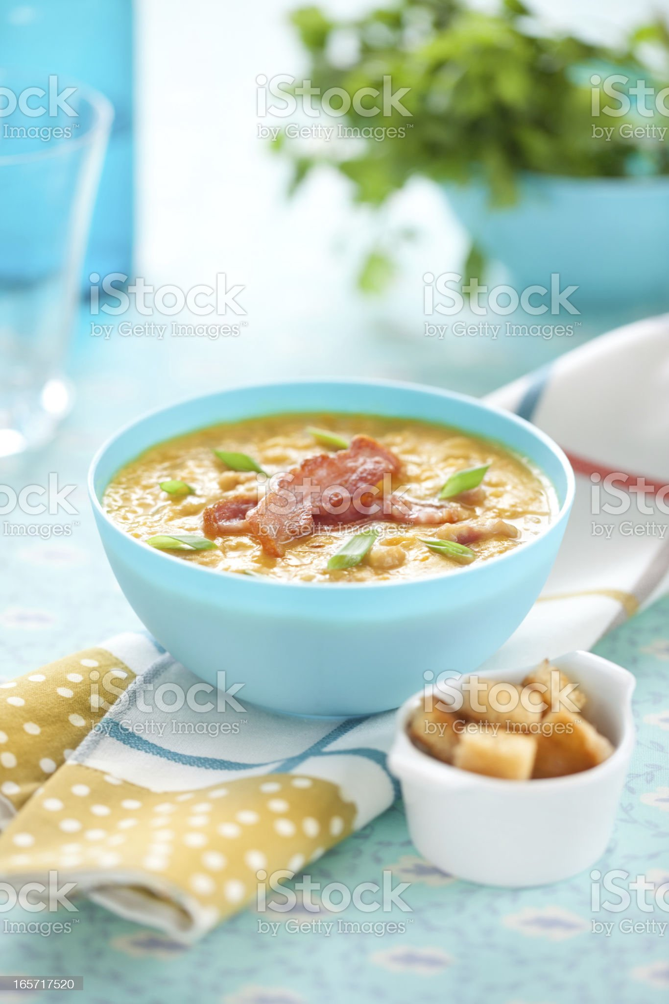 Pea soup with bacon and spring onion royalty-free stock photo