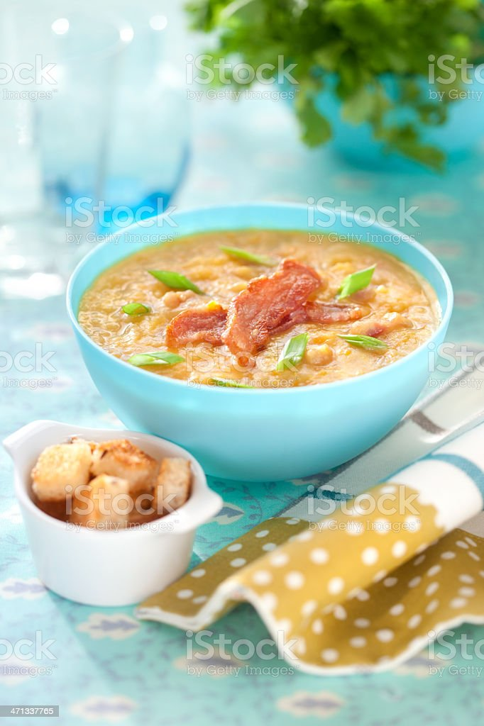 Pea soup with bacon stock photo