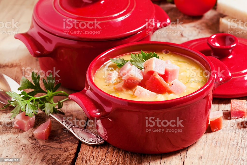 Pea soup with smoked meat stock photo