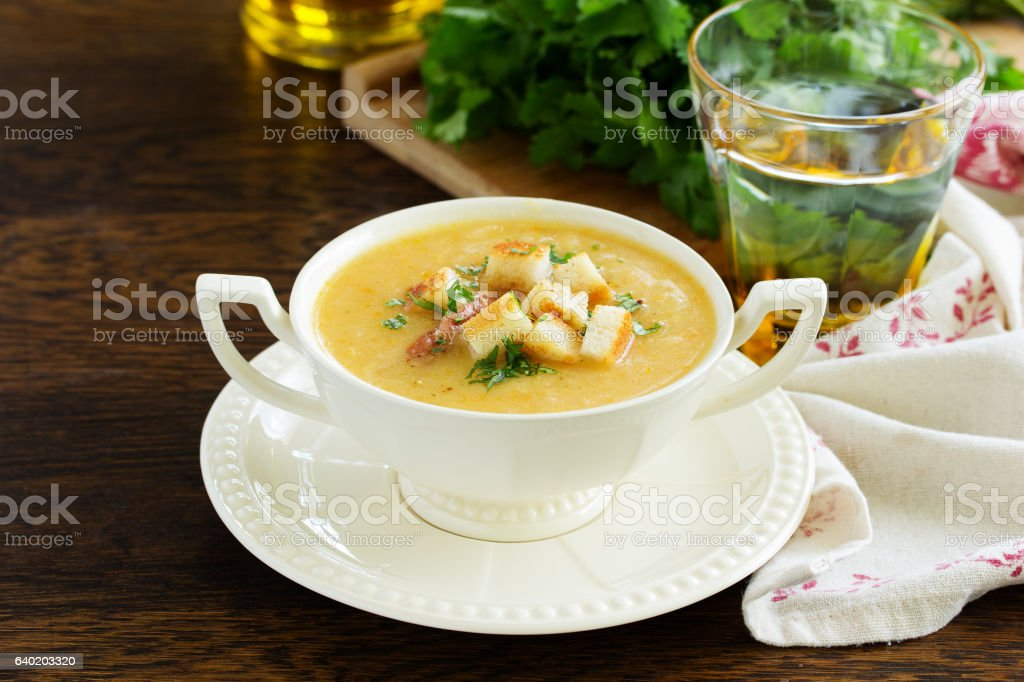Pea soup with smoked ribs and croutons. stock photo