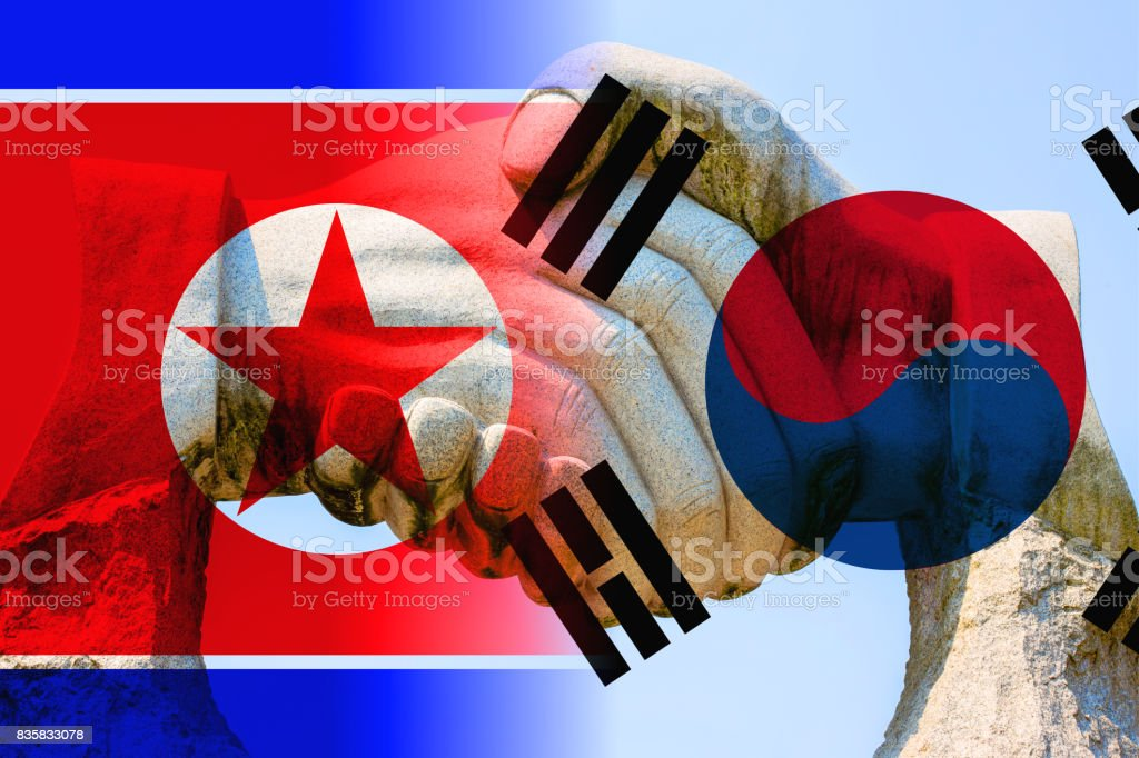 Peace between north and south korea with handshake stock photo
