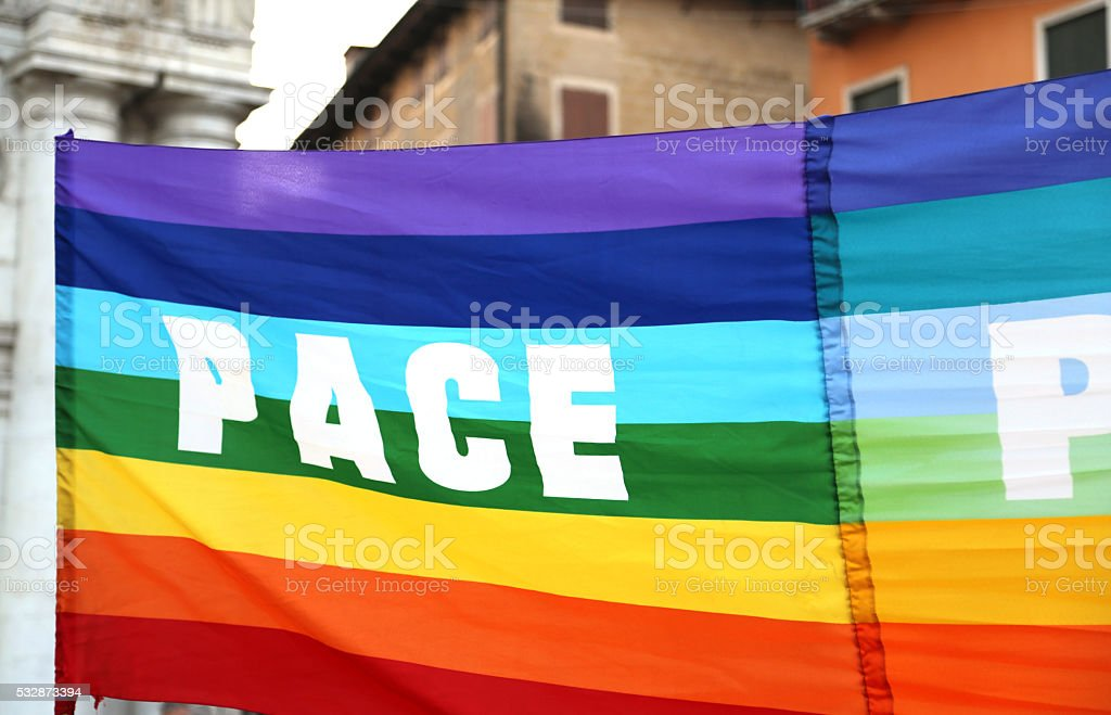 peace flag during a demonstration of peace activists stock photo