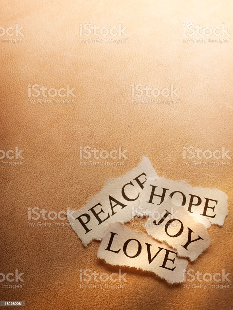 Peace, Hope,  Joy, and Love on brown background royalty-free stock photo
