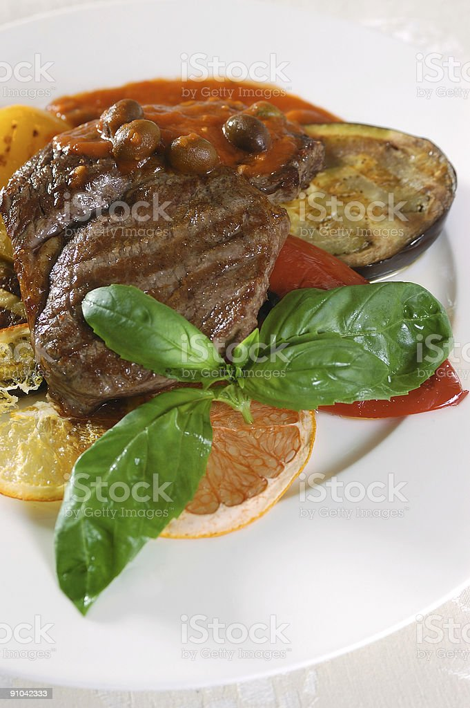 peace of fried meat with vegetables and lemon royalty-free stock photo