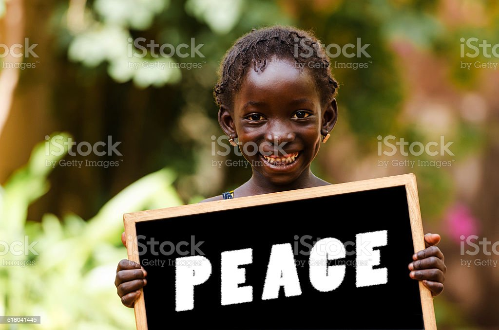 Peace On Earth - African Girl Holding Chalkboard stock photo