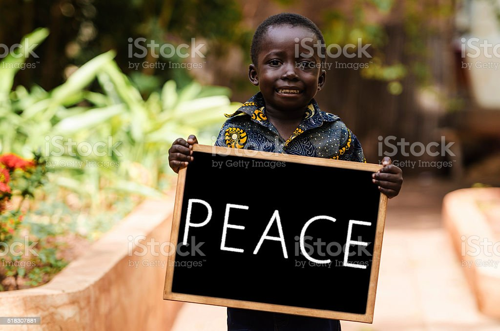 Peace on Earth Symbol - Black Boy Holding Blackboard stock photo