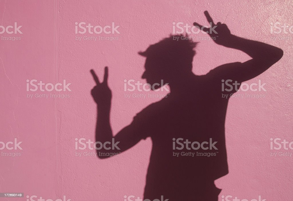 Peace Out Shadow Dude Man Relaxing Against Pink Wall royalty-free stock photo