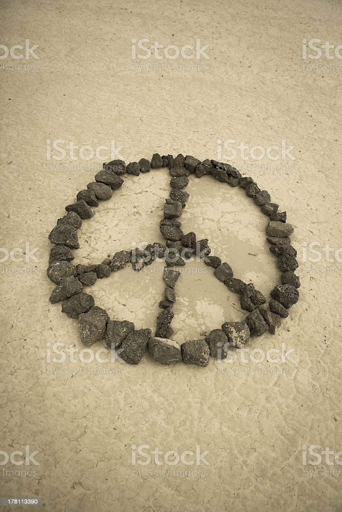 Peace shape made with stones royalty-free stock photo