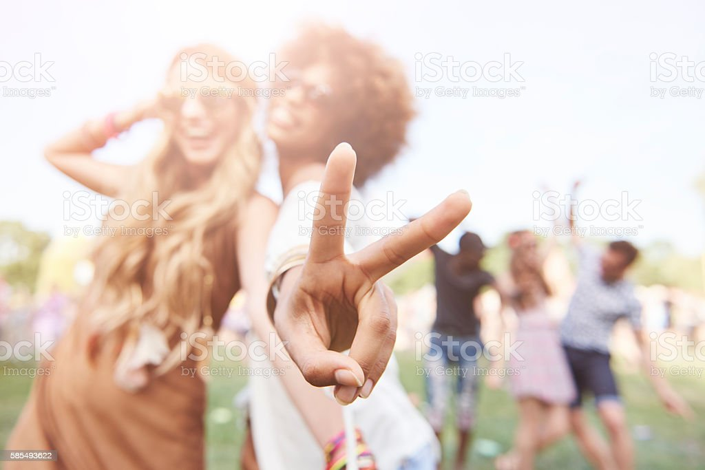 Peace sign made by african descent woman stock photo
