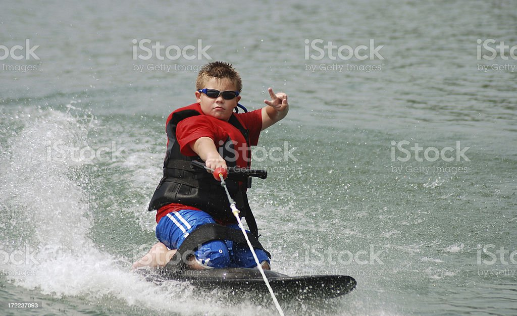 Peace Sign While Kneeboarding stock photo