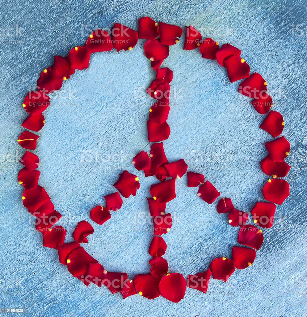 Peace sign with rose leaves royalty-free stock photo