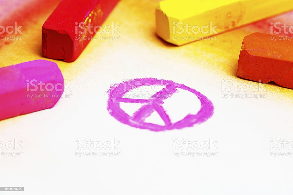 CND peace symbol in pink pastel on sketchpad stock photo
