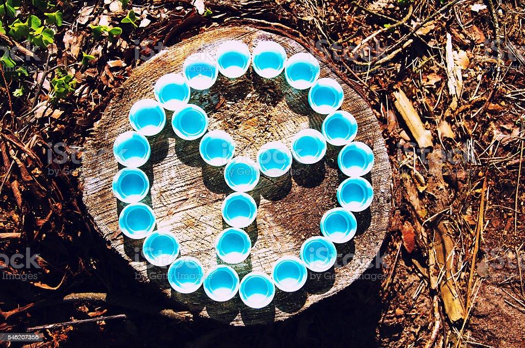 Peace symbol made of plastic caps stock photo