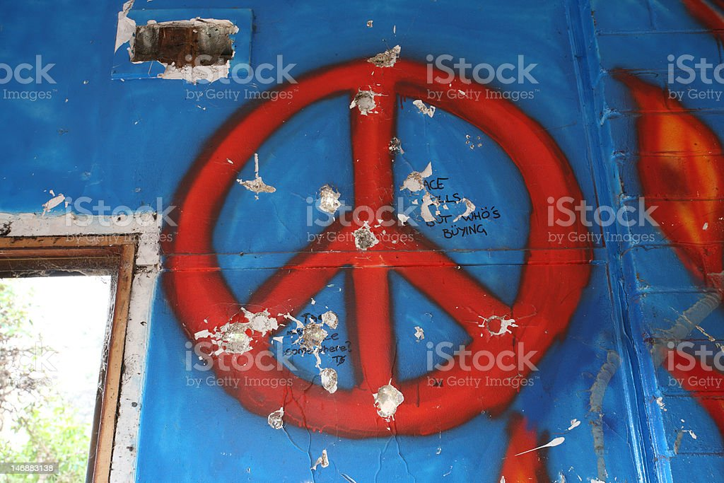 peace symbol on a wall stock photo