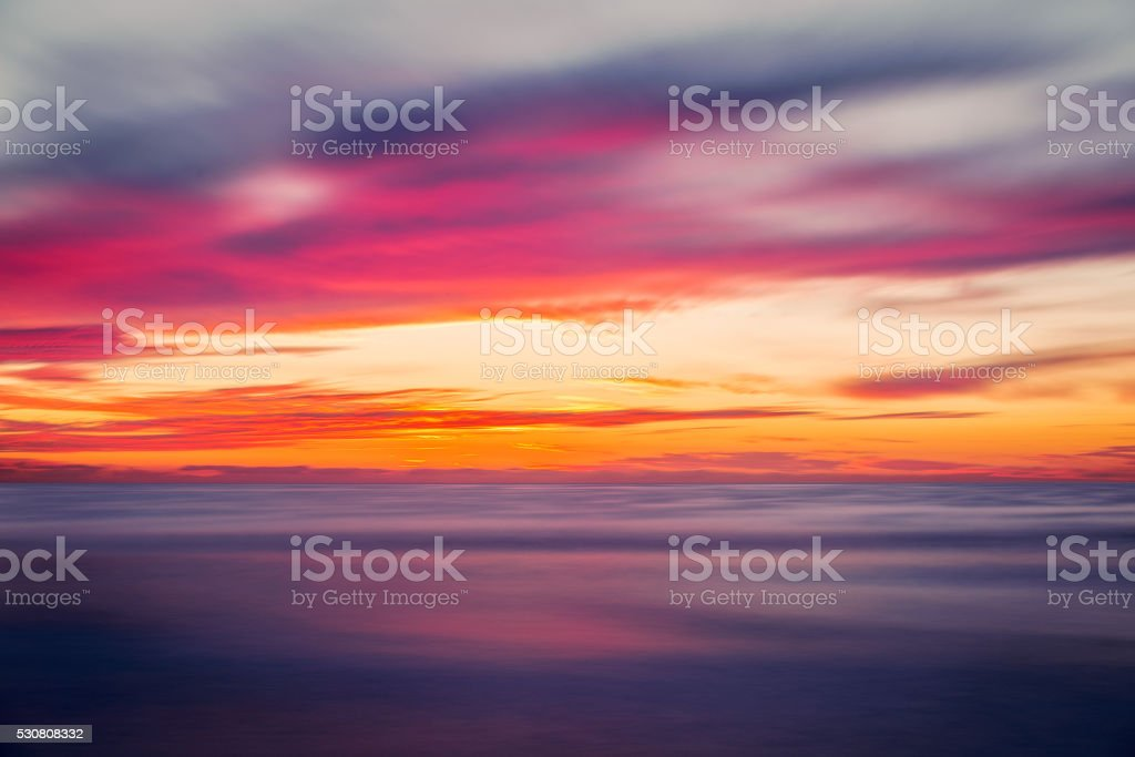 Peaceful and Colorful Sunset Over the Ocean stock photo