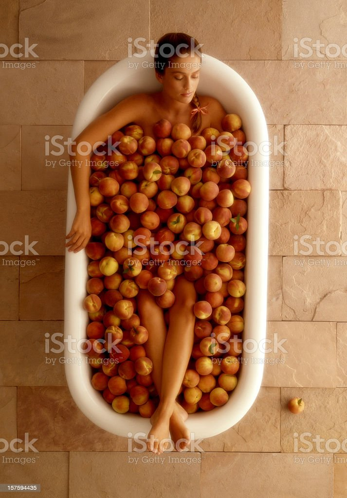 Peaceful Bath Full of Peaches stock photo
