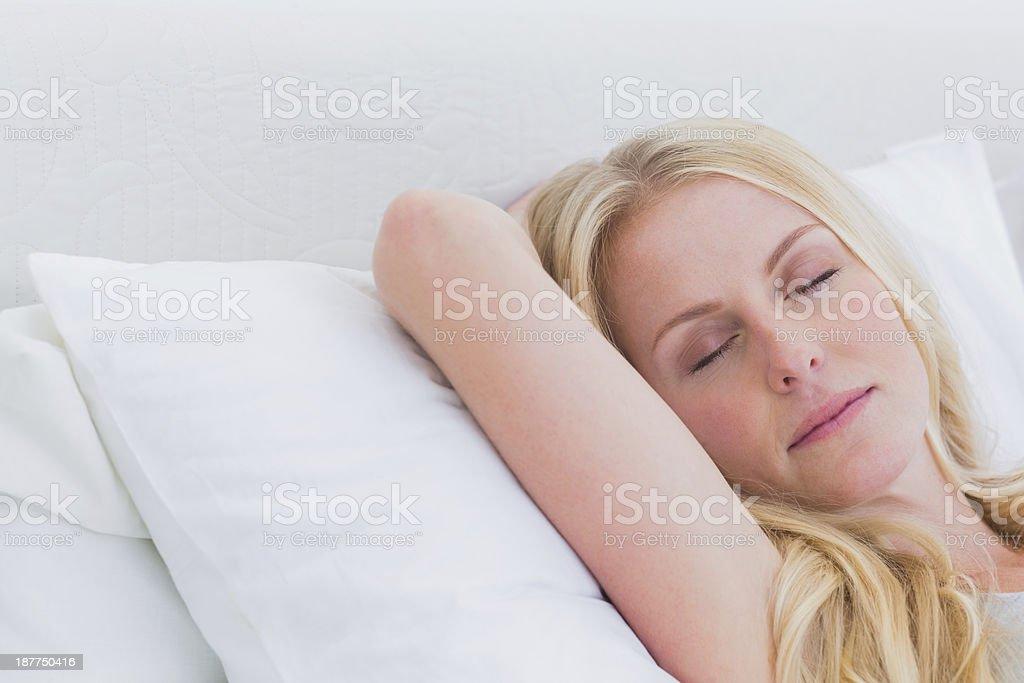 Peaceful blonde woman sleeping royalty-free stock photo