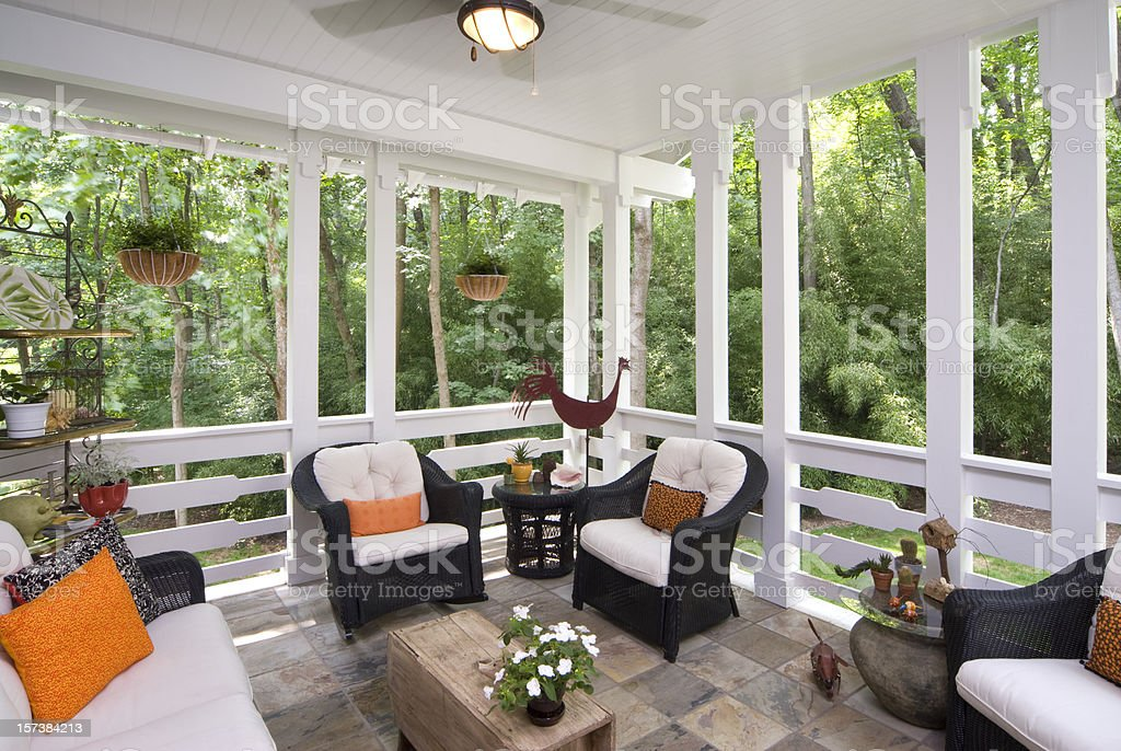 Peaceful enclosed back deck/porch with furniture stock photo