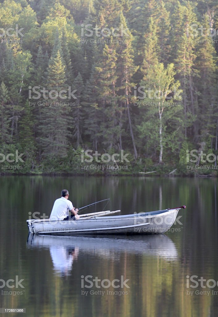 Peaceful Fisherman in Small Boat royalty-free stock photo