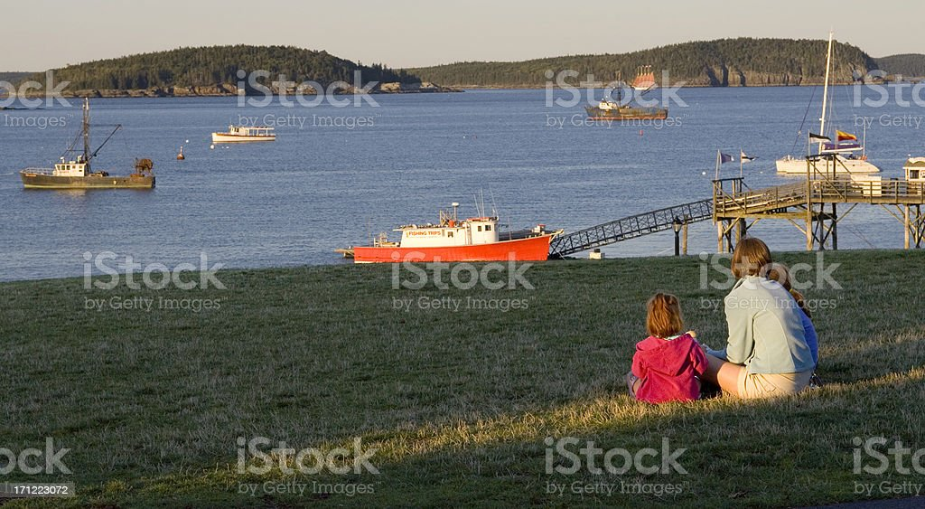 Peaceful harbor at sunset stock photo