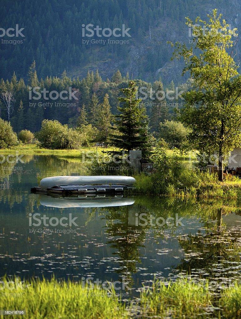 Peaceful lake and canoe royalty-free stock photo