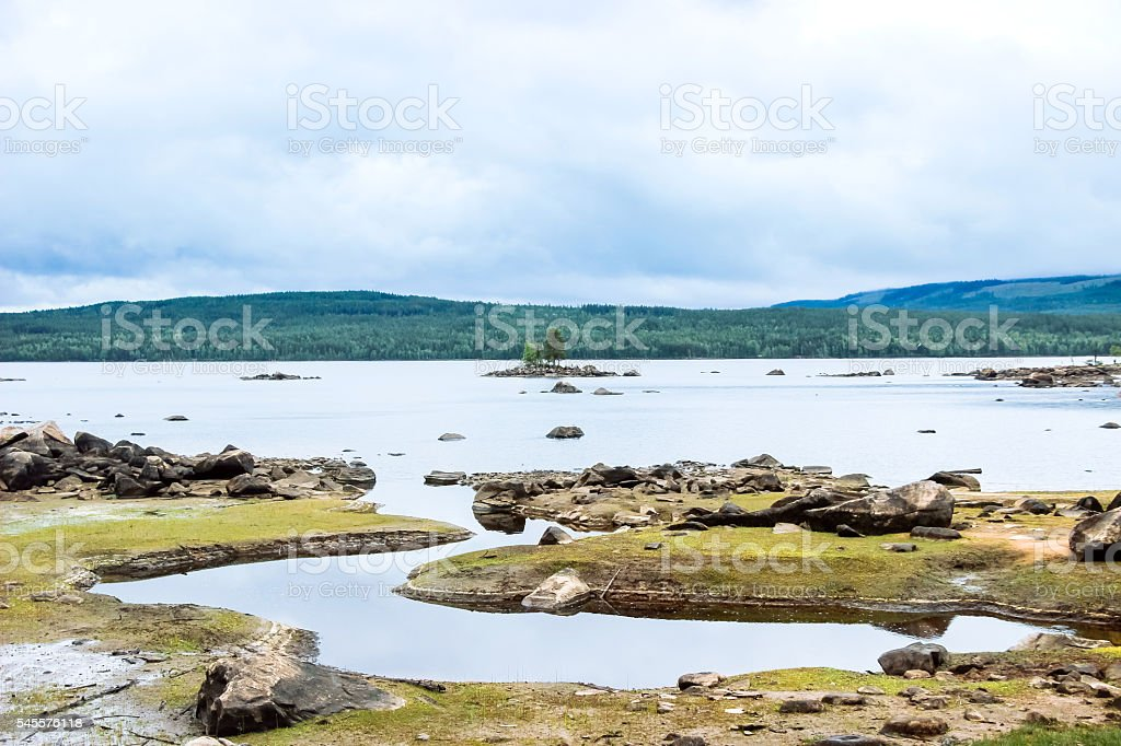 peaceful lake with grassland stock photo