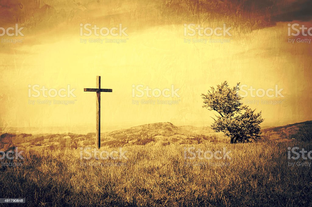 Peaceful landscape background with a cross stock photo
