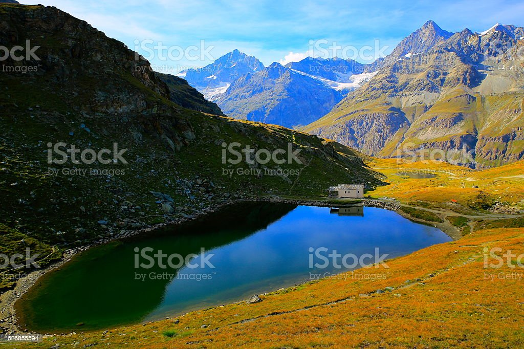 Peaceful landscape: Swiss alps, Alpine Schwarzsee lake, idyllic Christianity Chapel stock photo