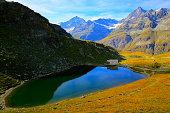 Peaceful landscape: Swiss alps, Alpine Schwarzsee lake, idyllic Christianity Chapel