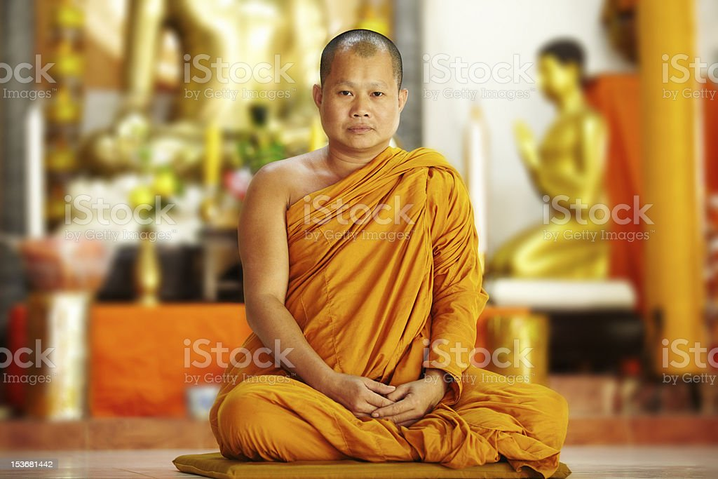 Peaceful monk in saffron robes stock photo