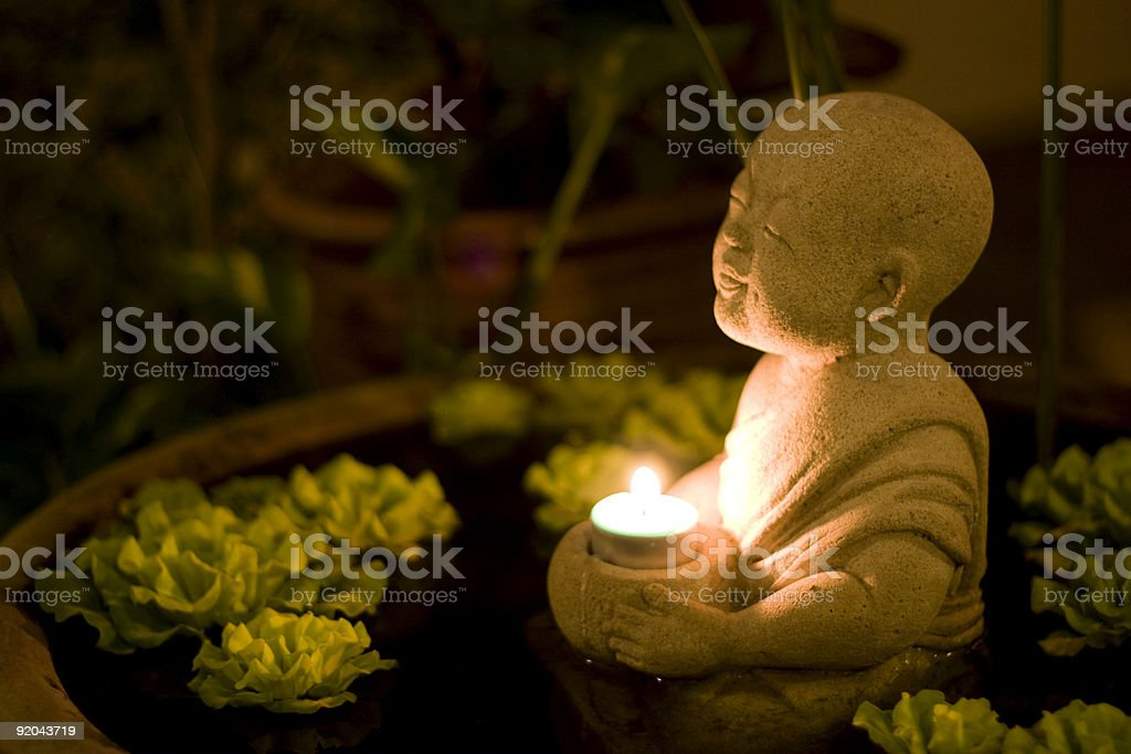 Peaceful monk statue in garden royalty-free stock photo