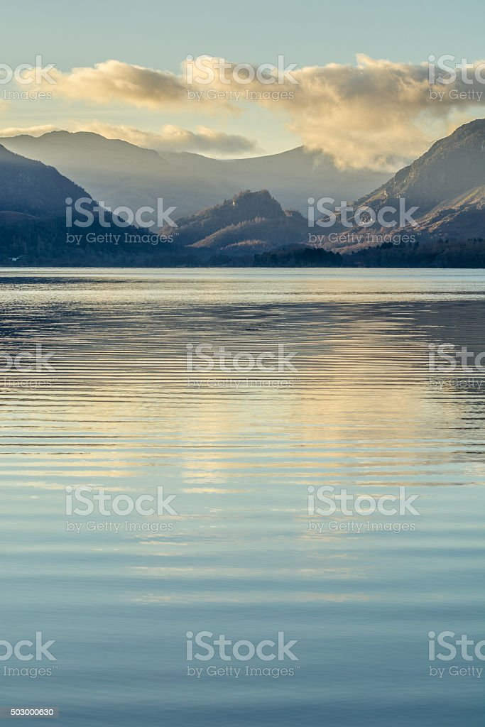 Peaceful Morning Scene At Derwentwater With Clouds Over Mountains. stock photo