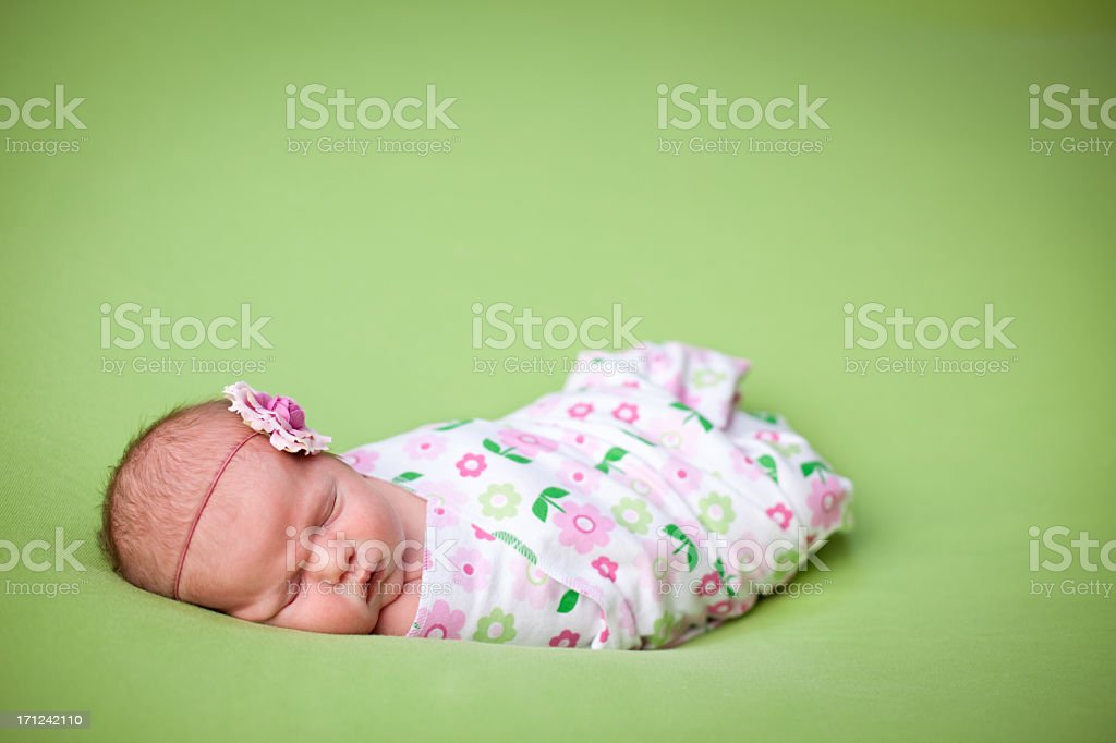 Peaceful Newborn Baby Girl Swaddled in Blanket, With Copy Space stock photo